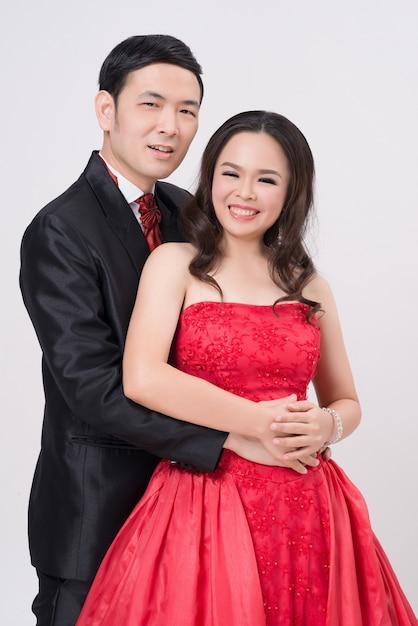 Par asiático, desgastar, vestido noite, e, vestido Foto Premium