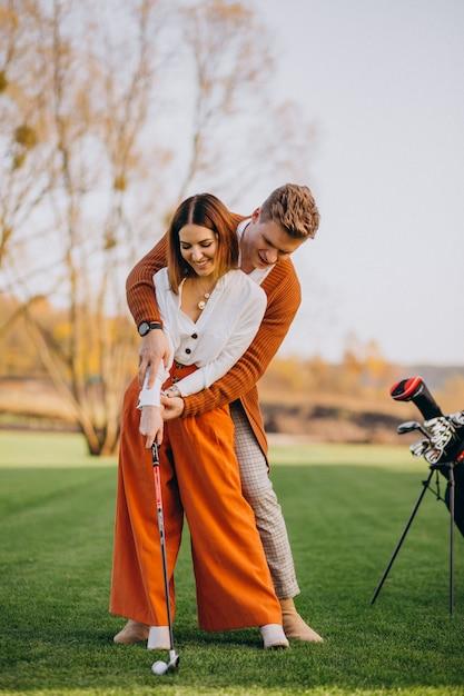 Par, golfe jogando, junto Foto gratuita