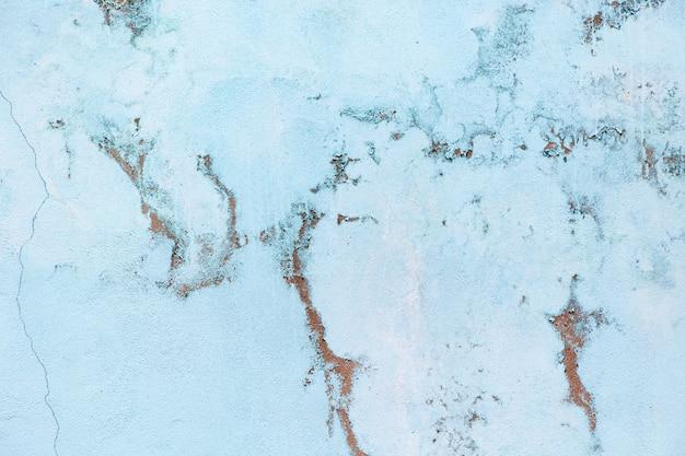 Parede azul pastel velha com escoriações Foto Premium