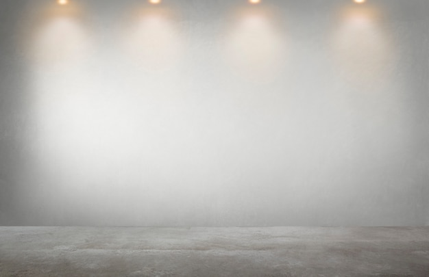 Parede cinza com uma linha de holofotes em um quarto vazio Foto gratuita
