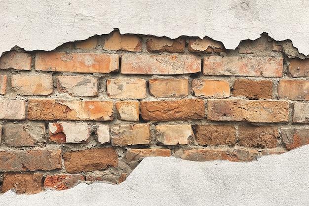 Parede com fundo de tijolos. textura de parede antigo. Foto Premium