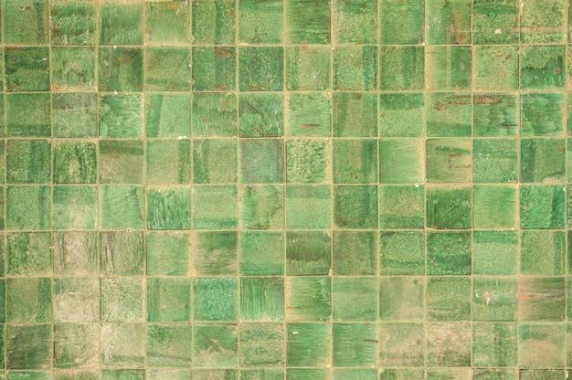 Parede com quadrados verdes Foto gratuita
