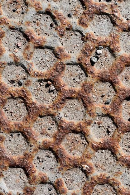 Parede com textura de favo de mel de aço enferrujada e arranhada Foto gratuita