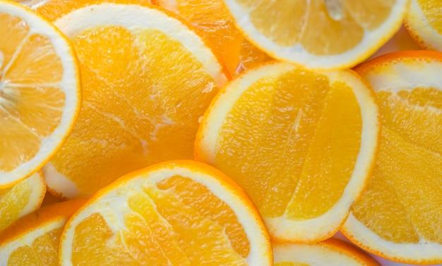 Parede de alimentos frescos fatias de laranja picada, cor laranja fresca para uso em fazer a parede, Foto Premium