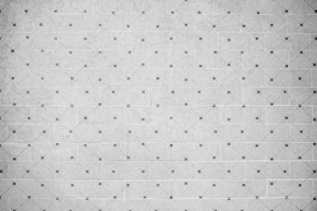 Parede de azulejos cinza Foto gratuita