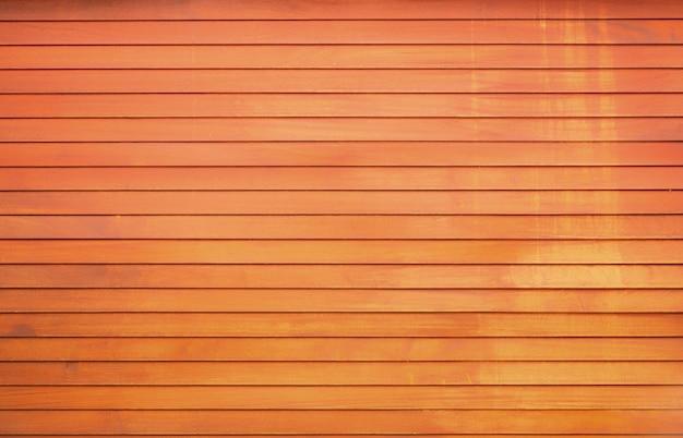 Parede de madeira natural, placas pintadas de laranja com tons de amarelo. fundo de textura de alta qualidade Foto Premium