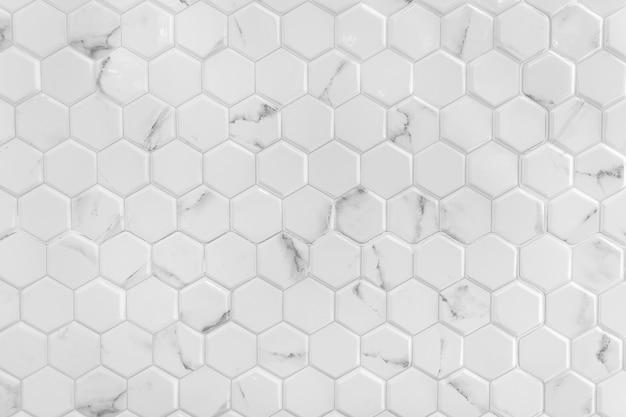 Parede de mármore branco com padrão de hexágono Foto Premium