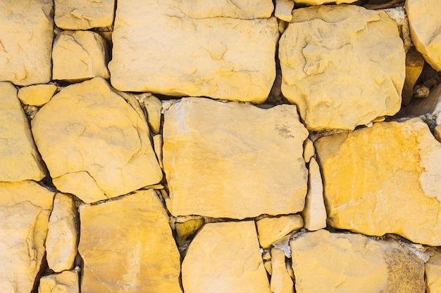 Parede de pedra marrom natural Foto gratuita