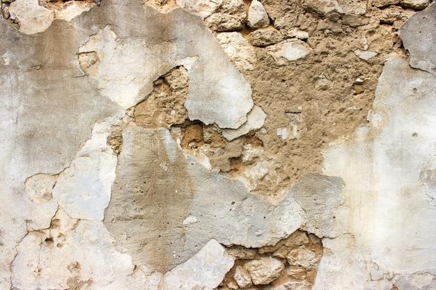 Parede de tijolo danificada velha com emplastro. fundo e texturas. Foto Premium