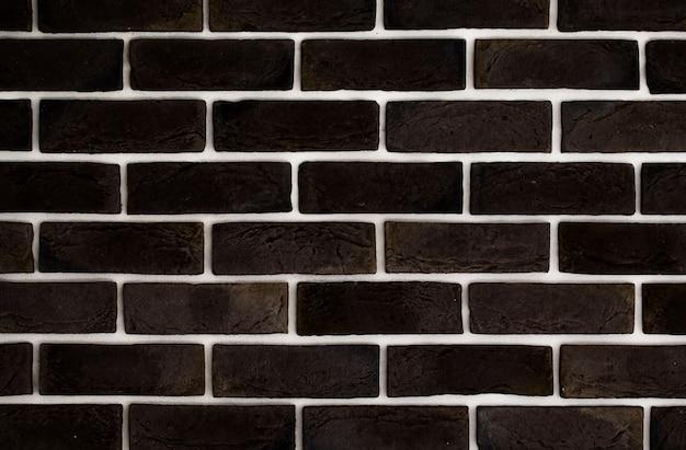 Parede de tijolo marrom escuro, fundo criativo, close-up Foto gratuita