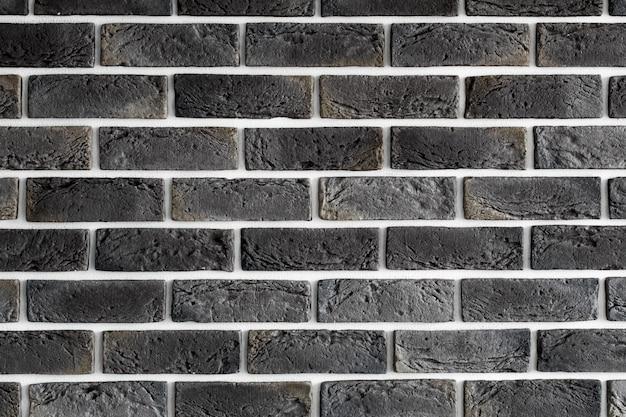 Parede de tijolo marrom escuro Foto gratuita