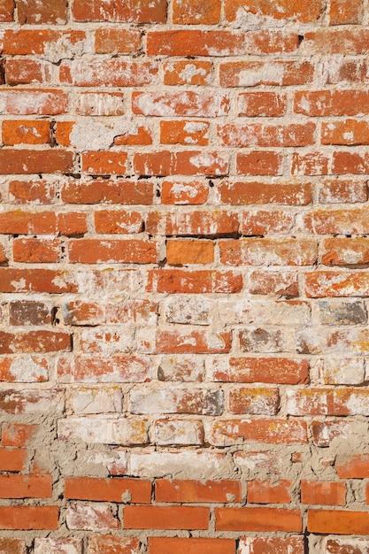 Parede de tijolo vermelho velho. pode ser usado como plano de fundo ou textura. Foto Premium