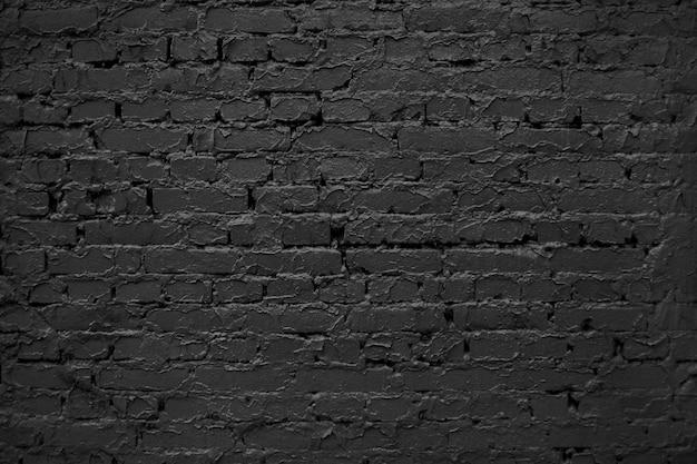 Parede de tijolos antigos abstrato preto. textura de tijolos pretos. superfície de parede áspera escura. Foto Premium