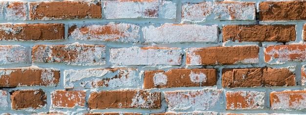 Parede de tijolos antigos com tijolos vermelhos e brancos Foto Premium