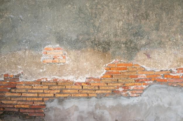 Parede de tijolos antigos na antiguidade e danificados Foto Premium