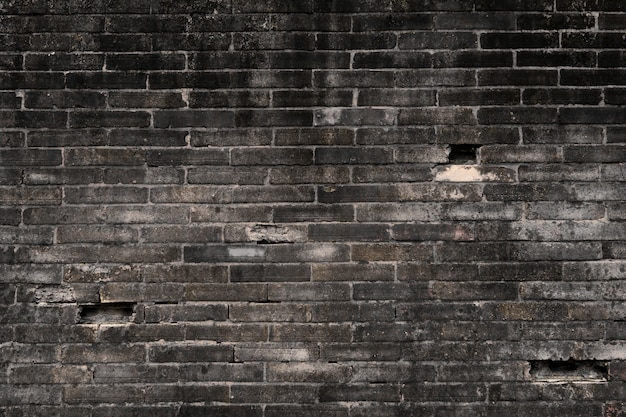 Parede de tijolos antigos Foto Premium