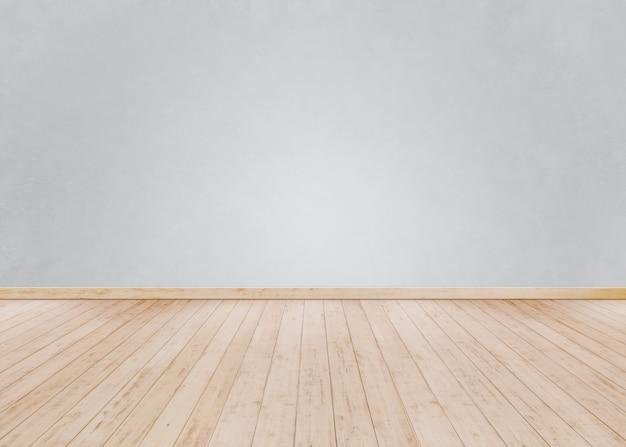 Parede de tijolos brancos com piso de madeira Foto Premium
