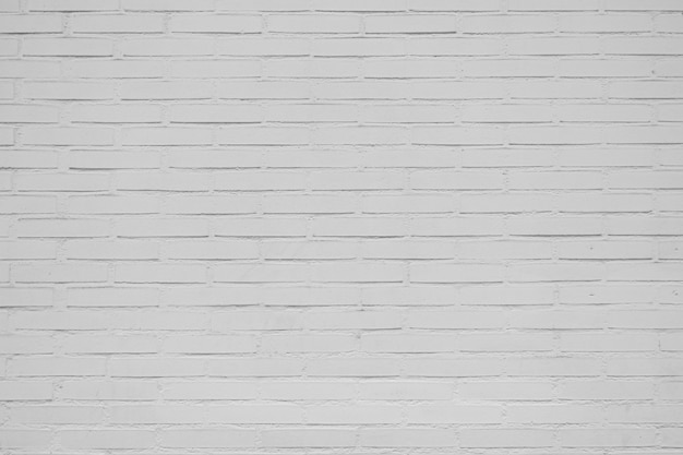 Parede de tijolos brancos velhos grandes para o fundo Foto gratuita