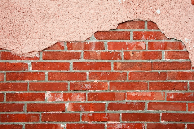 Parede de tijolos com concreto rachado Foto Premium
