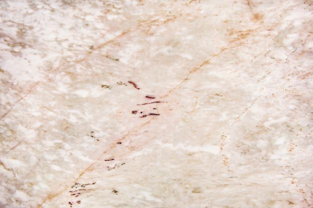 Parede texturizada de mármore rosa e branco Foto gratuita