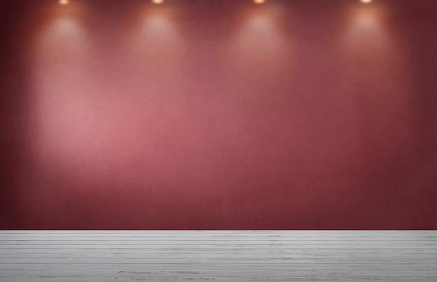Parede vermelha com uma fileira de holofotes em um quarto vazio Foto gratuita