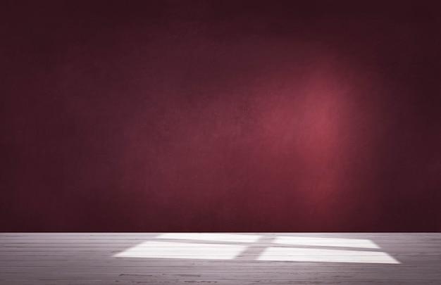 Parede vermelha de borgonha em um quarto vazio com piso de concreto Foto Premium