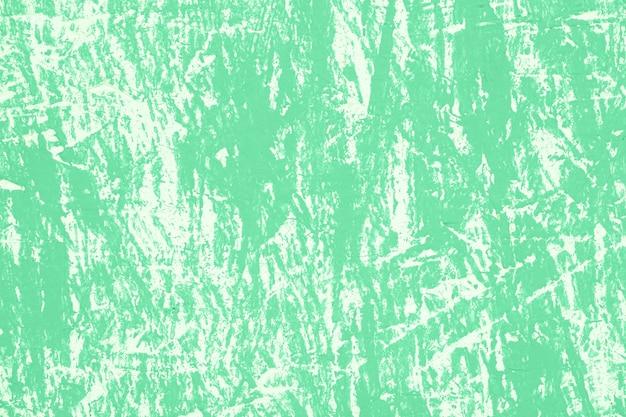Parede vintage verde com arranhões Foto gratuita
