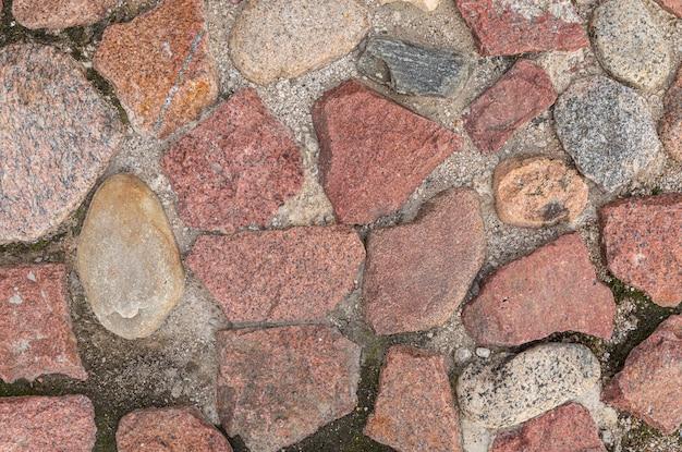 Pavimento de pedras de granito principalmente vermelho, padrão sem emenda, textura Foto Premium