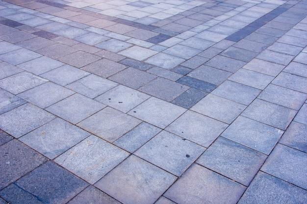 Pavimento de tijolos cinza na cidade em diagonal Foto Premium