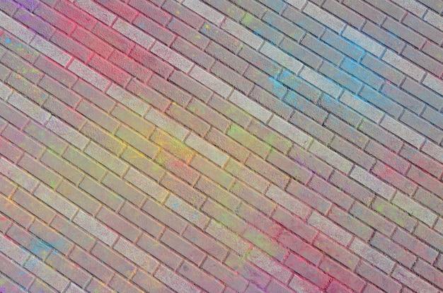 Pavimentos multicoloridos, pintados a pó com cores secas no festival holi Foto Premium