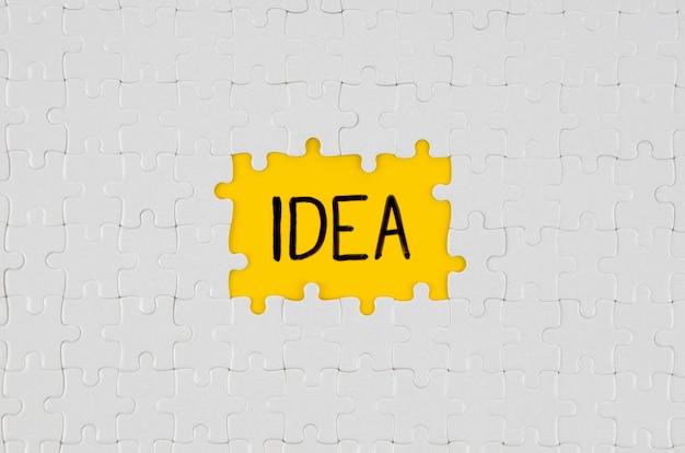 Peças brancas de texto de idéia de quebra-cabeça Foto gratuita