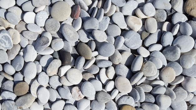 Pedras do mar cobble texture com muitas cores espalhadas Foto Premium
