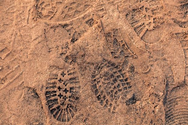 Pegadas de textura na areia Foto Premium