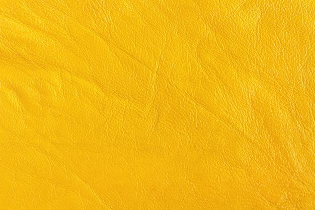 Pele artificial na cor amarela. fundo, textura. Foto Premium