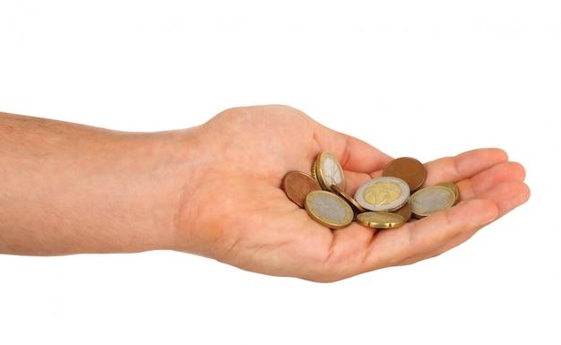 Pequena mudança do euro na mão masculina Foto Premium