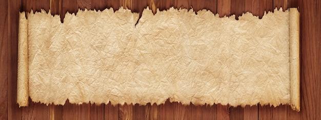 Pergaminho antigo em uma mesa de madeira, textura de papel amassado Foto Premium
