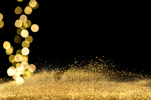 Perto das luzes do bokeh com glitter dourado Foto gratuita