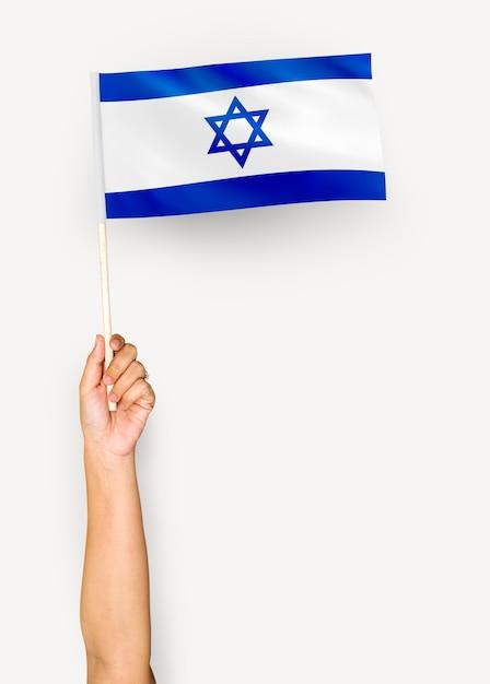 Pessoa, waving, a, bandeira, de, estado israel Foto gratuita