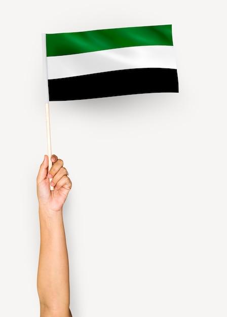 Pessoa, waving, bandeira, de, islamic, estado, de, afeganistão Foto gratuita
