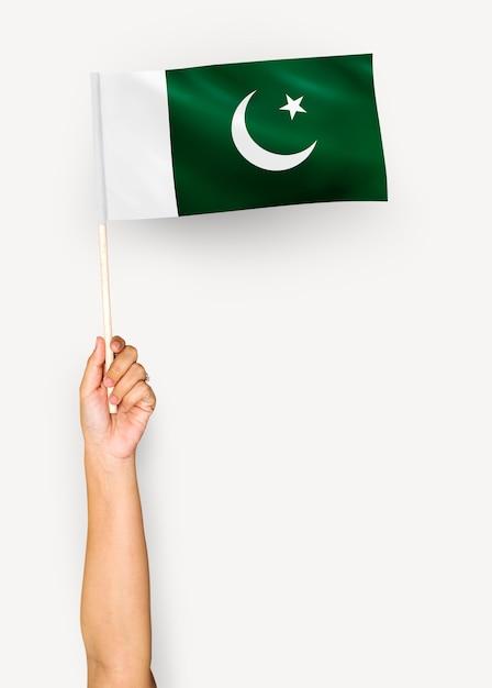 Pessoa, waving, bandeira, islamic, república, paquistão Foto gratuita
