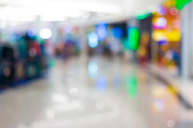Pessoas abstratas do borrão no shopping. Foto Premium