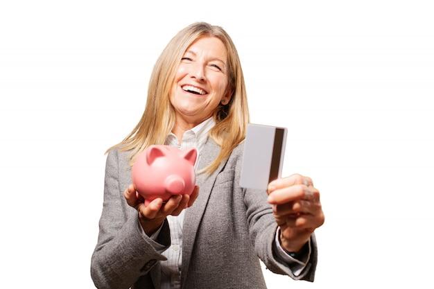 Piggy divertimento fêmea bancária legal Foto gratuita