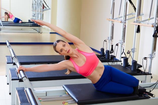 Pilates reformer woman mermaid exercise Foto Premium