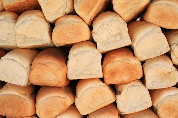 Pilha da textura do fundo de muitos naco de pães. Foto Premium