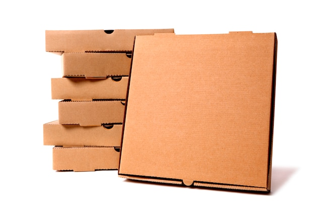 Pilha de caixas de pizza marrom Foto Premium