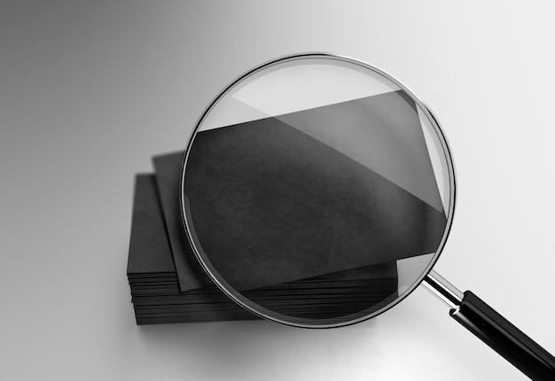 Pilha de cartões de visita preto sob a lupa Foto Premium