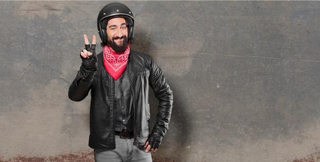 Piloto de moto comemorando uma vitória Foto Premium