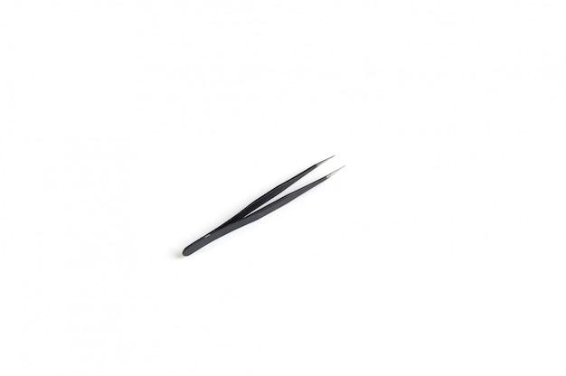 Pinça reta para cílios preto no branco Foto Premium