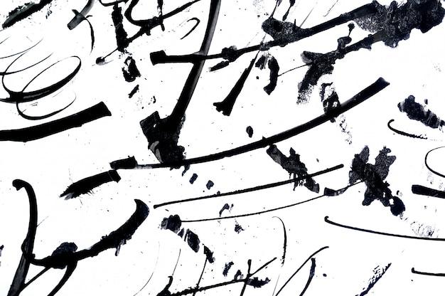 Pinceladas abstratas e salpicos de tinta no papel. Foto Premium