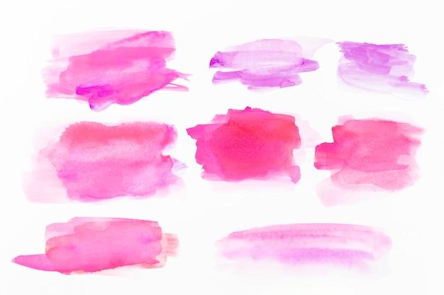 Pinceladas de aquarela rosa Foto gratuita